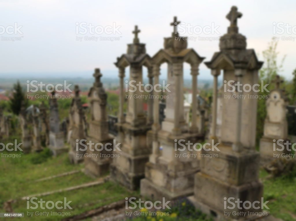 Old cemetery with stone monuments, blur background foto stock royalty-free