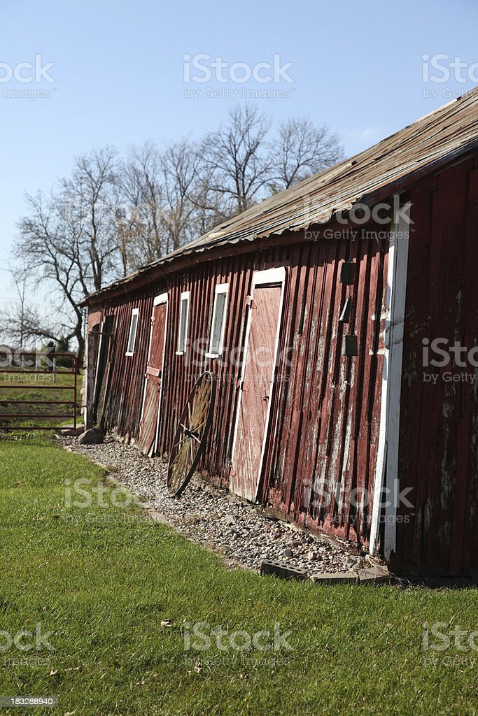 Old centennial barn side with warn red painted walls stock photo
