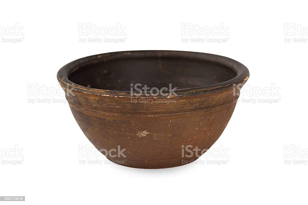 Old ceramic bowl on a white background. stock photo