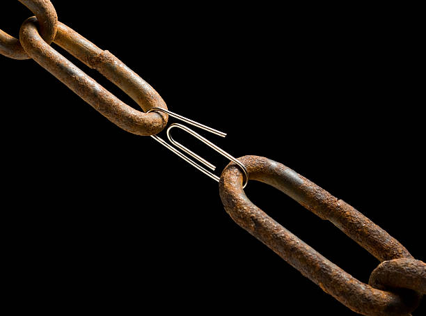 Old chain and new paperclip stock photo