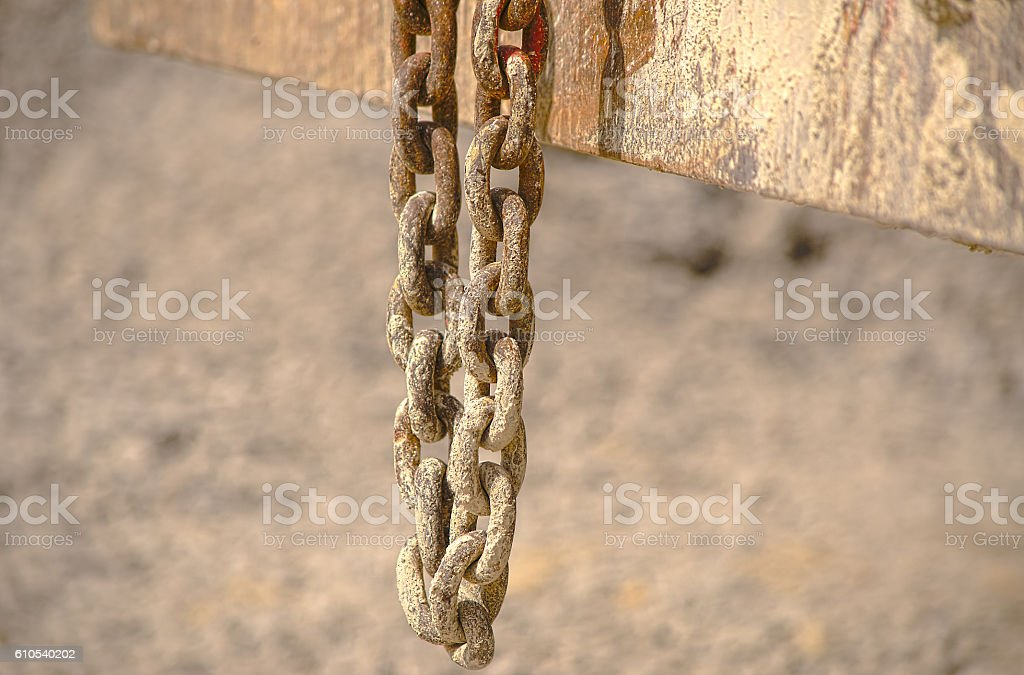 HDR old chain hangs on a excavator in a plant stock photo