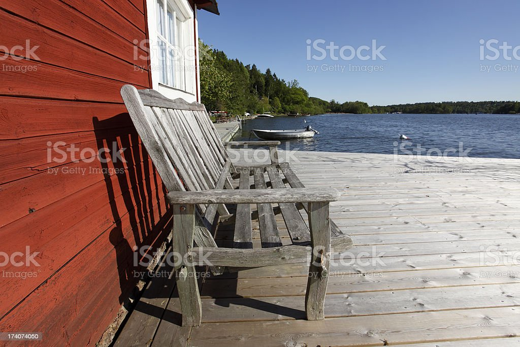 Old chair in Scandinavian lakeside retreat royalty-free stock photo