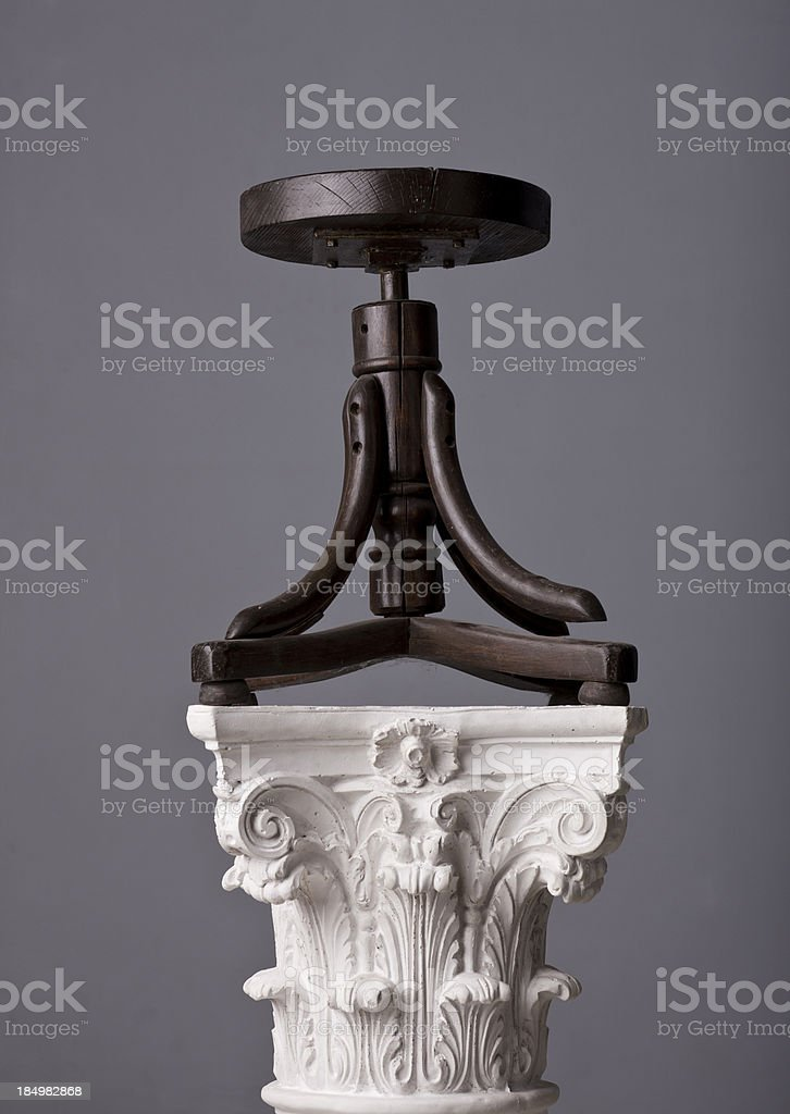 old chair on a corinthian capital royalty-free stock photo