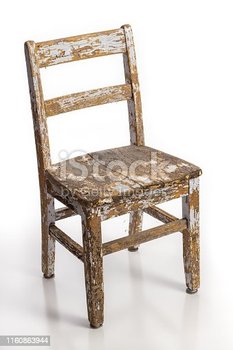 Old wooden chair with texture of flaking cracked paint peeling off isolated on a white background. Lead contamination concept.