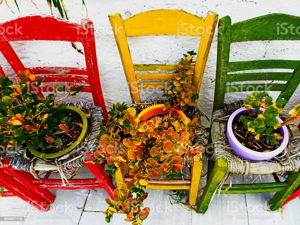 Old chairs transformed to flower pots, Syros, Greece stock photo