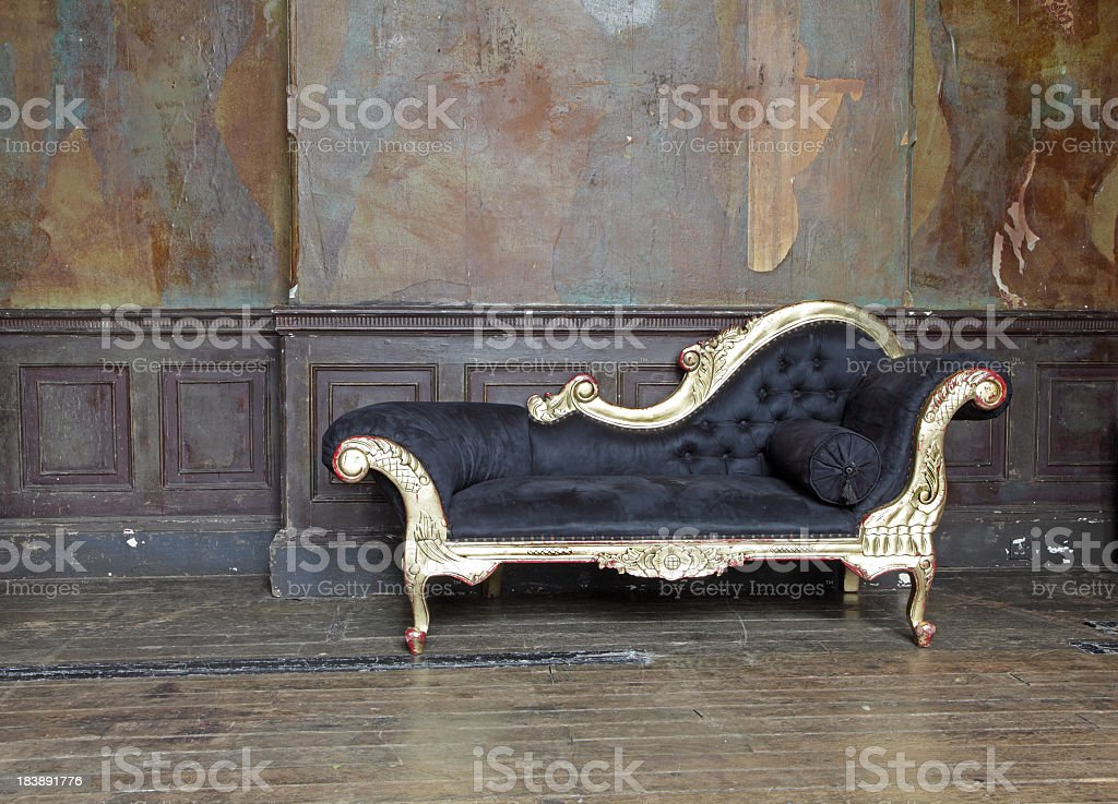 Old chaise lounge in old room  stock photo