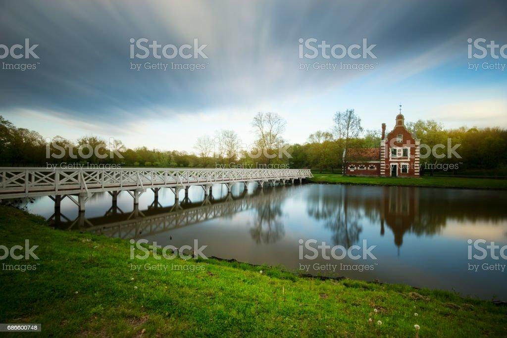 Old chapel near lake in Hungary stock photo
