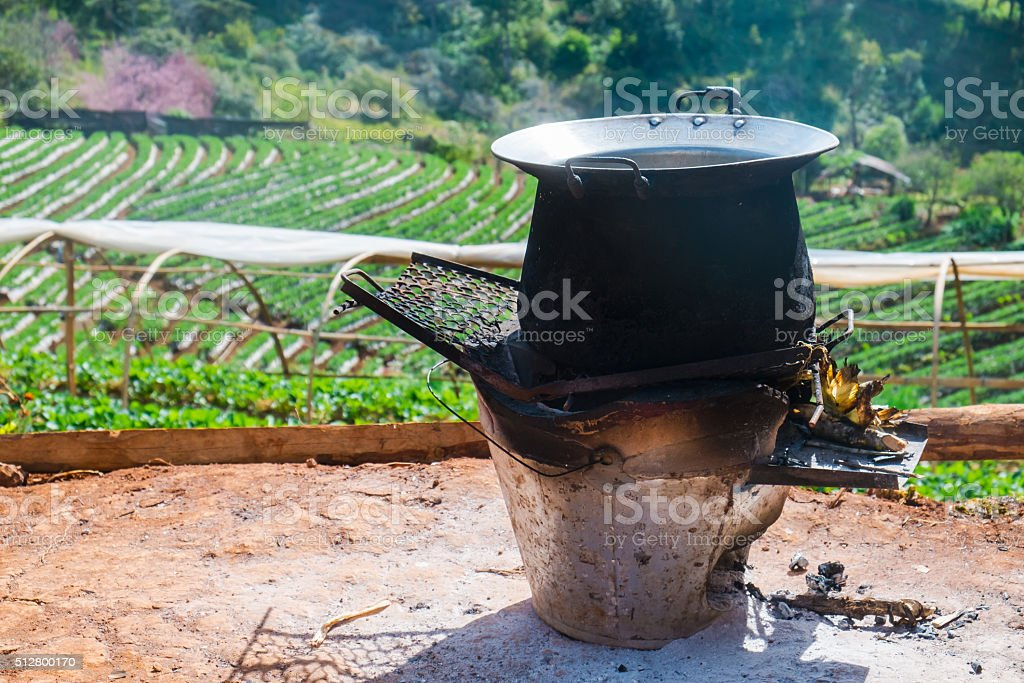 Old charcoal stove with old pot stock photo