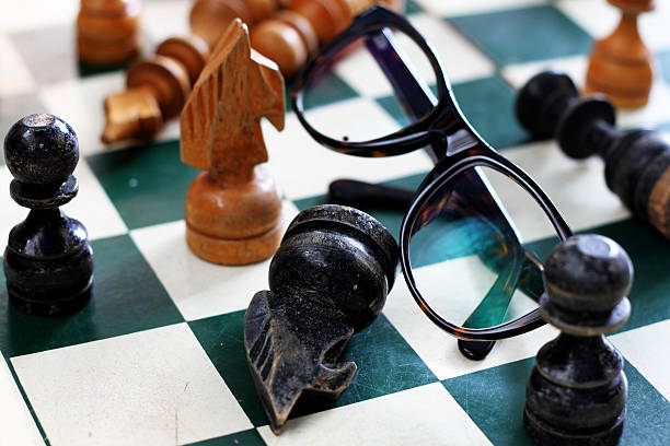 old chess board with chess pieces stock photo