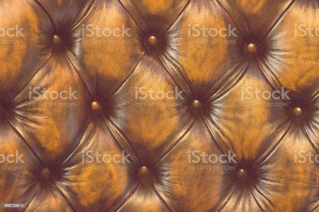 Old Chesterfield button back sofa stock photo