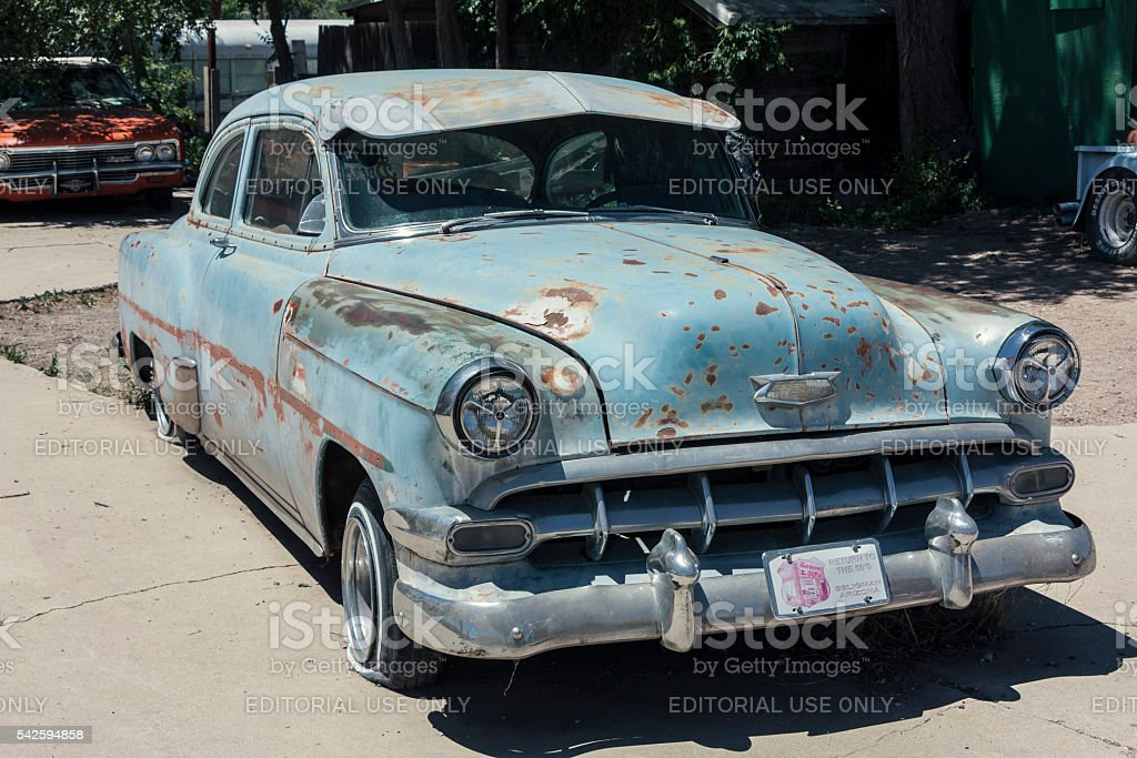 Old Chevrolet car near route 66 stock photo