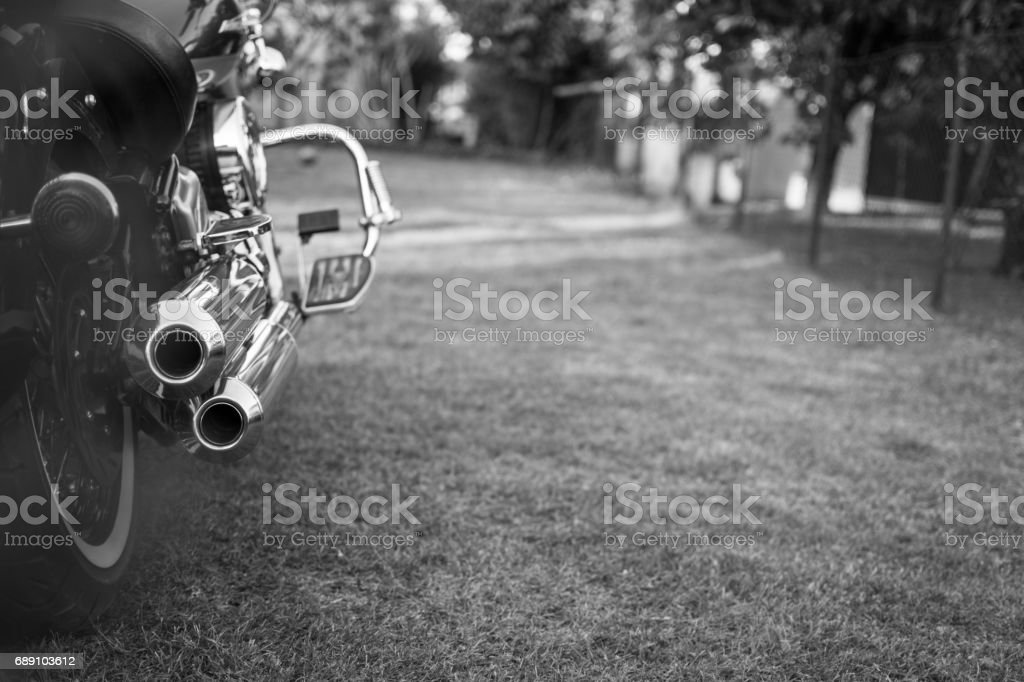 Old chopper motorcycle with chromed exhaust stock photo