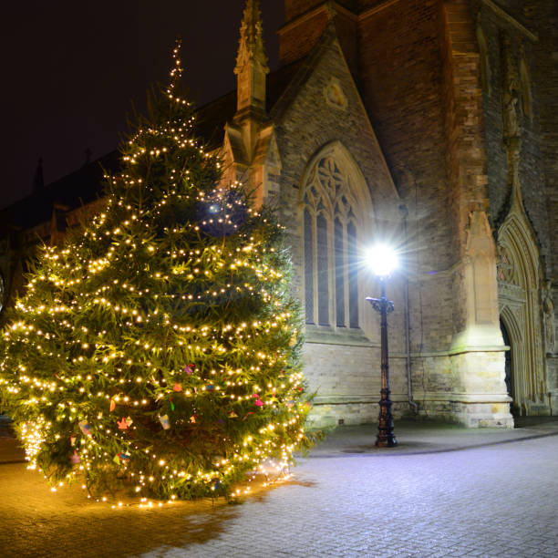Old Church and Christmas Tree at Night stock photo