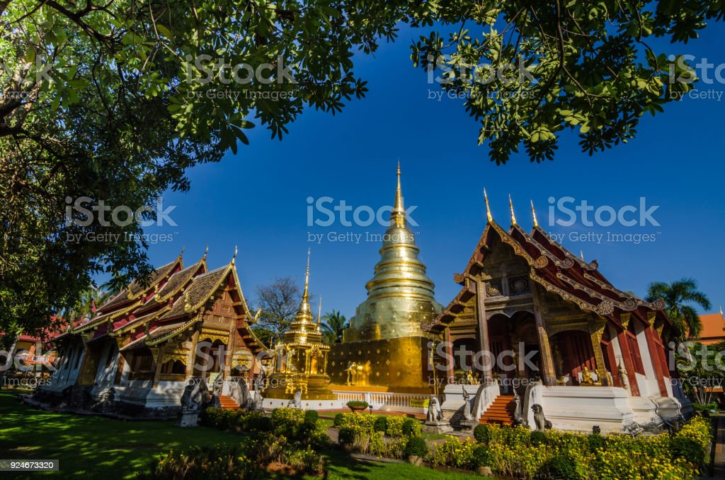 Old Church and golden pagoda at phra singh temple stock photo