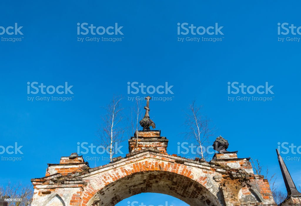 Old Church archway, overgrown with birches, Russia. royalty-free stock photo