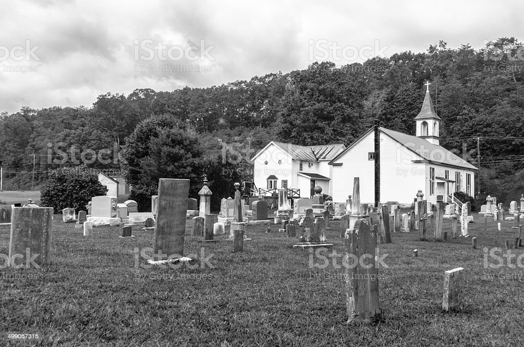 Old Church Building And Cemetery In B & W stock photo
