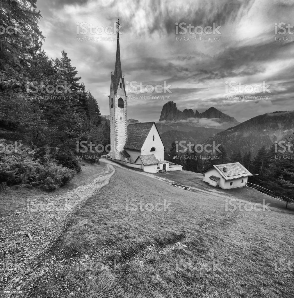 Old church by mountains. stock photo