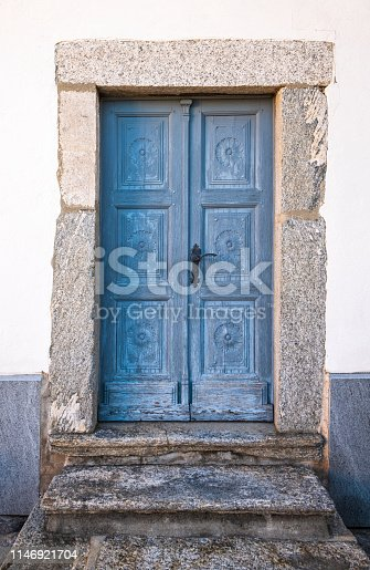Old church door at the church San Martino in the village Ronco sopra Ascona at the Swiss part of the beautiful lake Lago Maggiore.