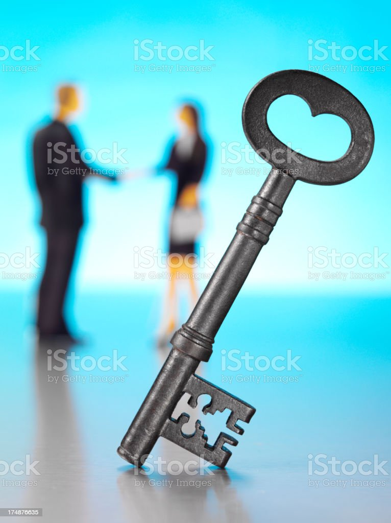 Old Church Key and Business People Shaking Hands stock photo