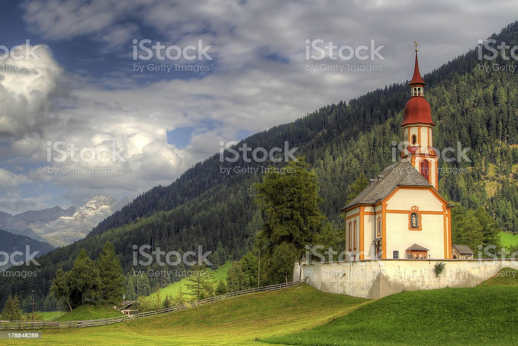 Old church on mountain with glaciated peak in background. royalty-free stock photo