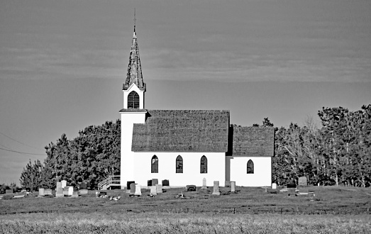 Old church on the Alberta prairie with cemetery