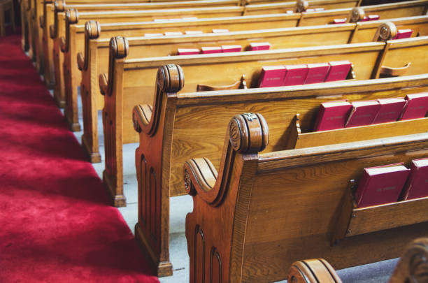 Old church pews and aisle stock photo