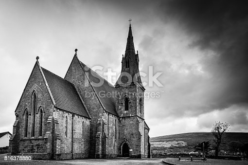 An old church in black and white set against a dramatic sky outside the small town of Kinvara, County Galway, Ireland