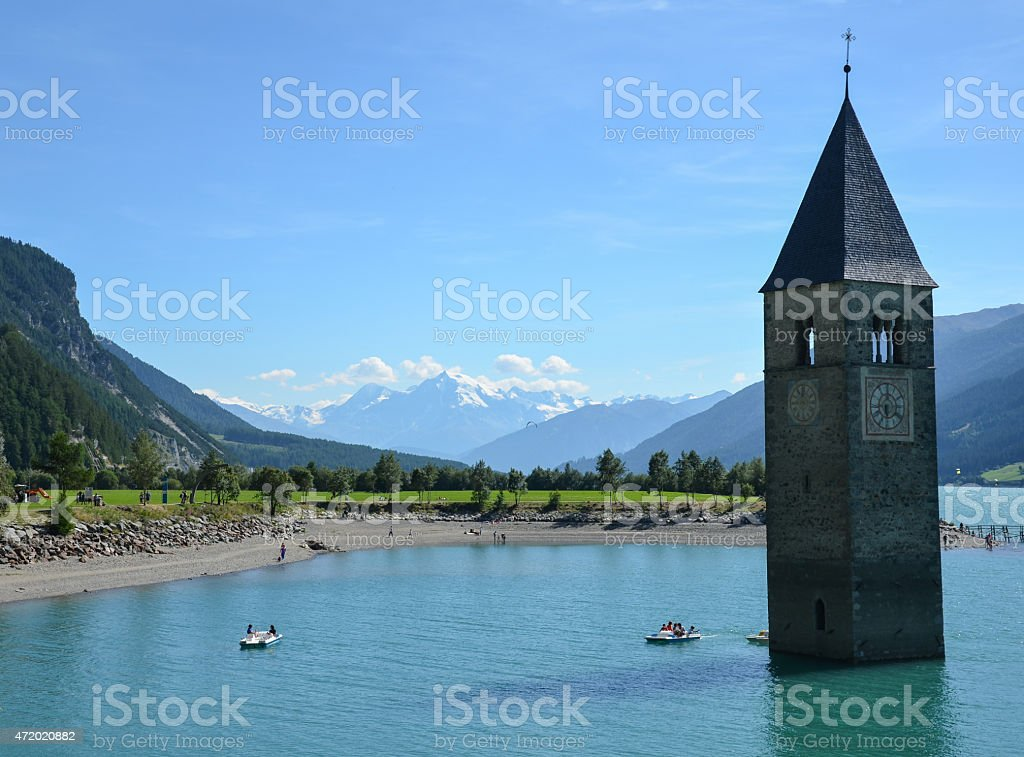 """Old Church tower in Curon Venosta (Graun im Vinschgau), Italy Old semi-submerged bell tower in Curon Venosta (Graun im Vinschgau), Italy on the lake """"Lago di Resia"""". 2000-2009 Stock Photo"""