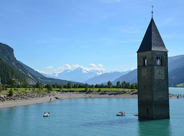 Old Church tower in Curon Venosta (Graun im Vinschgau), Italy stock photo