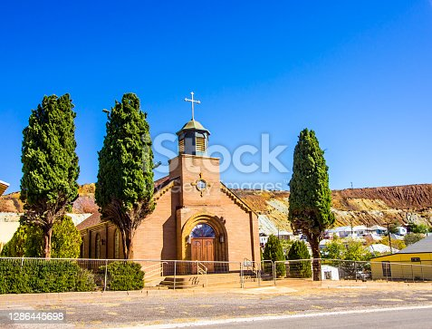 Old Church With Steeple, Cross & Double Doors In Small Mining Town