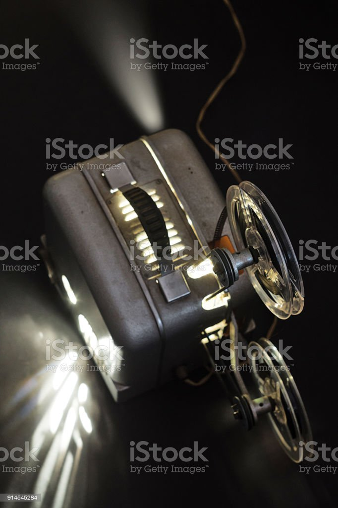 Old Cinema Projector And Cassettes In The Dark Royalty Free Stock Photo