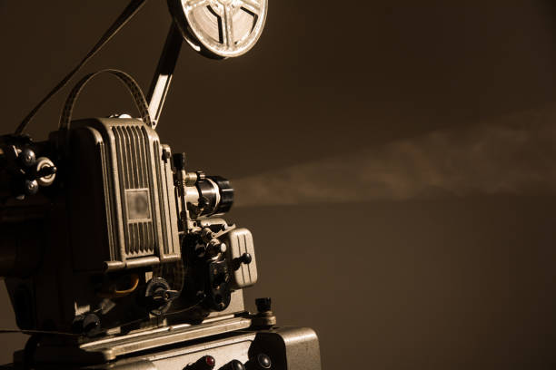 Old cinema projector on a dark background stock photo