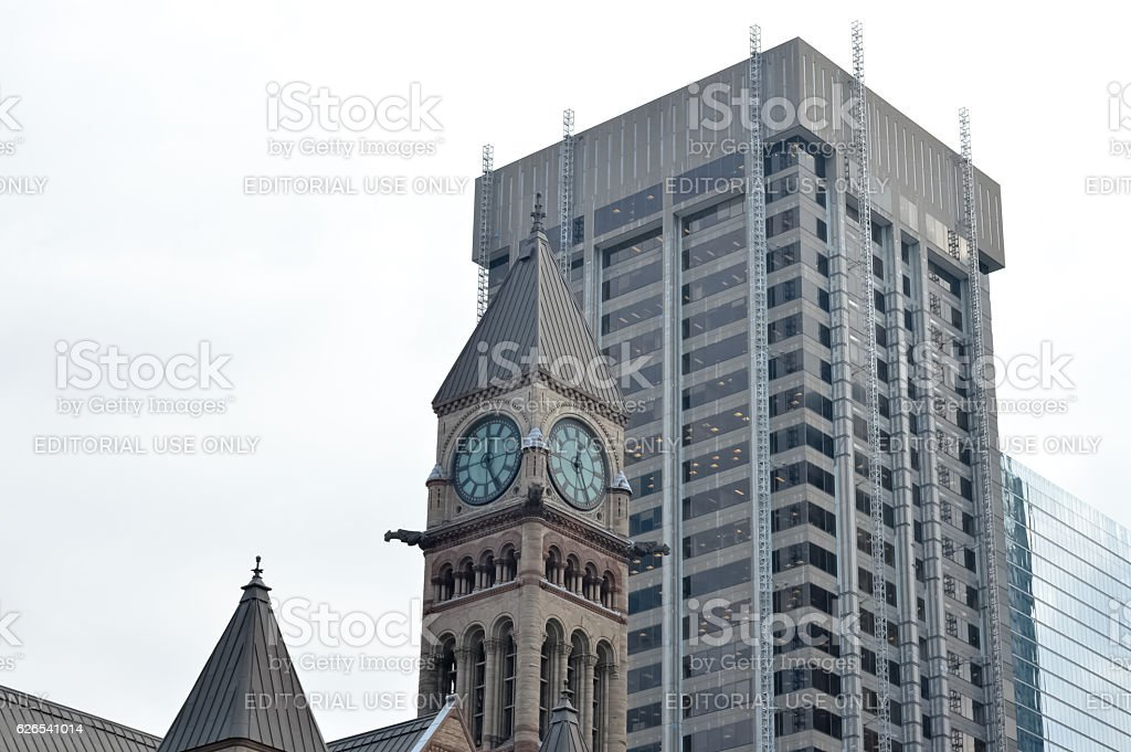 Old city hall  clock tower and skyscraper in Toronto stock photo