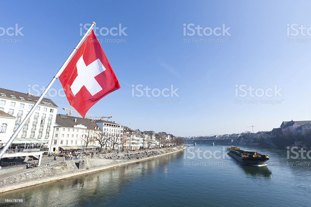 Old City of Basel River Rhine with Swiss Flag stock photo