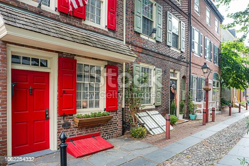 Stock photograph of a row of historic townhouses in the Old City district of Philadelphia Pennsylvania USA.