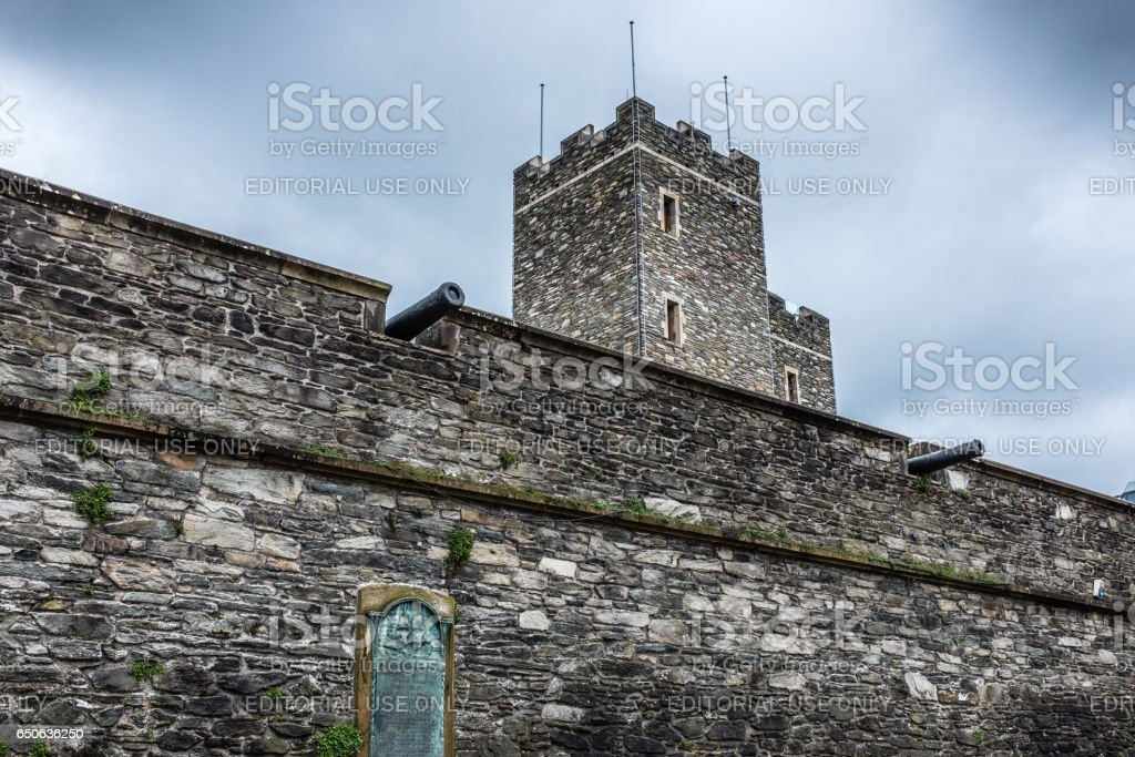 Old City Wall showing cannons and Tower Museum stock photo