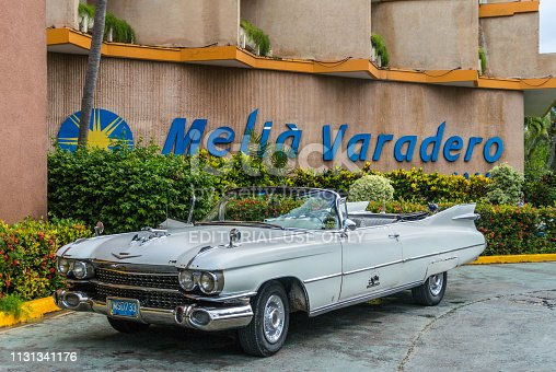 Varadero, Cuba - September 16, 2013: Vintage old classic American car in front of the Melia Varadero Hotel in Varadero, Cuba.