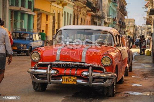 Havana, Cuba - January 20, 2013: Old classic American car park on street of Havana,CUBA. Old American cars are iconic sight of Cuba street.