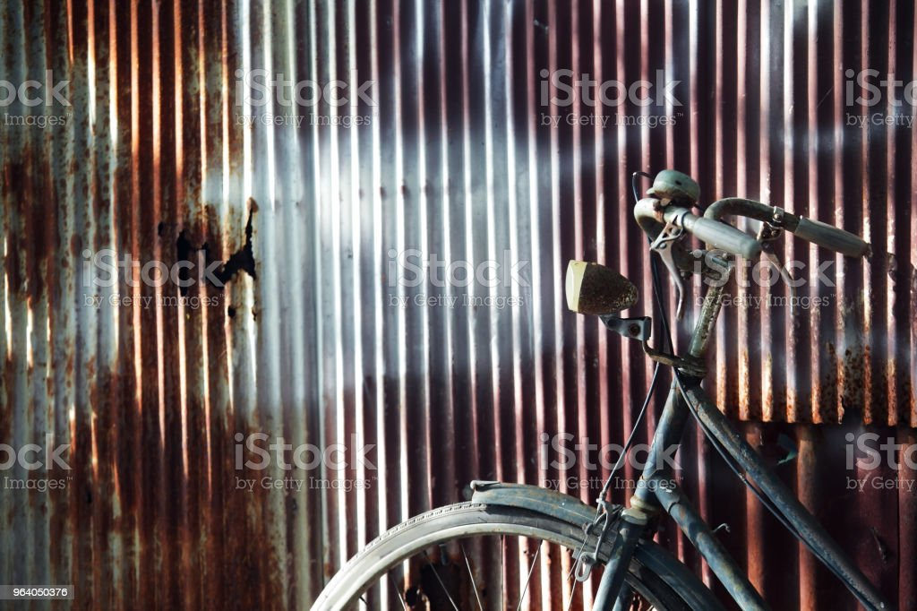 old classic bicycle with grunge rusty corrugated wall background. - Royalty-free Abstract Stock Photo