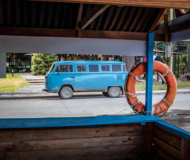 Old classic blue van near lifeguard cabin stock photo