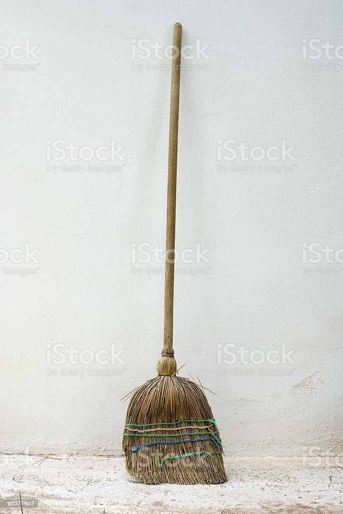 old classic Broomstick against wall royalty-free stock photo