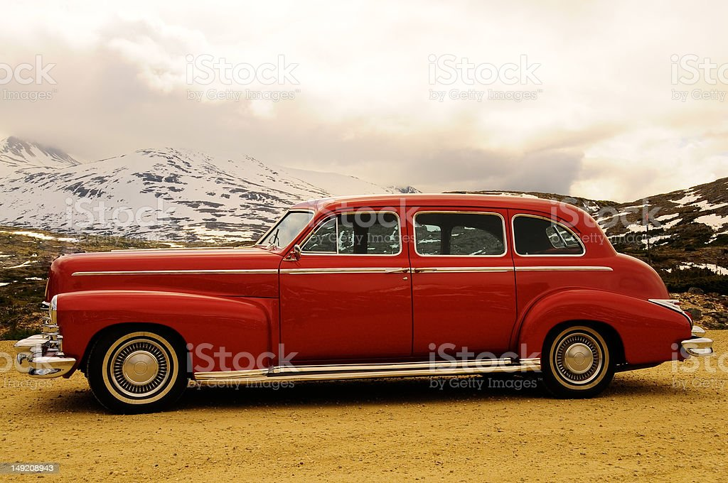 Old Classic red car parked in the mountains royalty-free stock photo