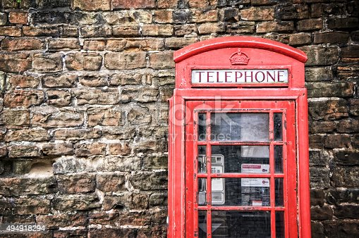Old classic red telephone booth with copy space