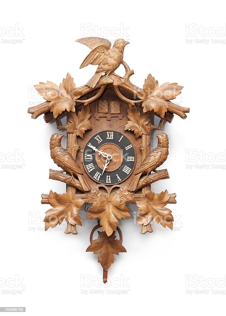 Old classic wooden cuckoo clock hung on a white wall stock photo