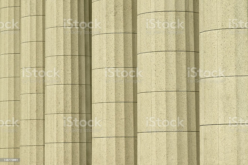 Old Classical stone columns with vintage building background royalty-free stock photo