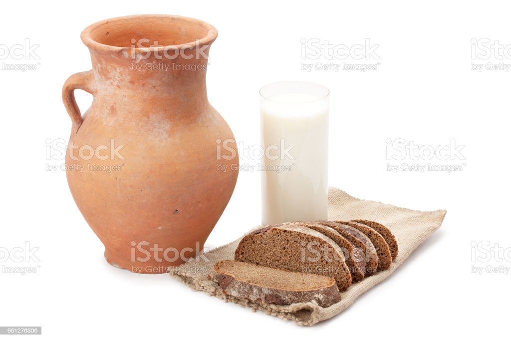 old clay jug, a glass of milk and bread stock photo