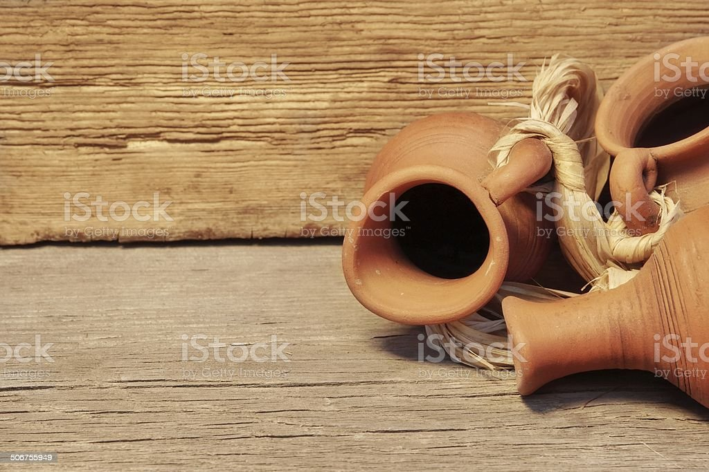 Old Clay Jugs Garland in Grunge wood background stock photo