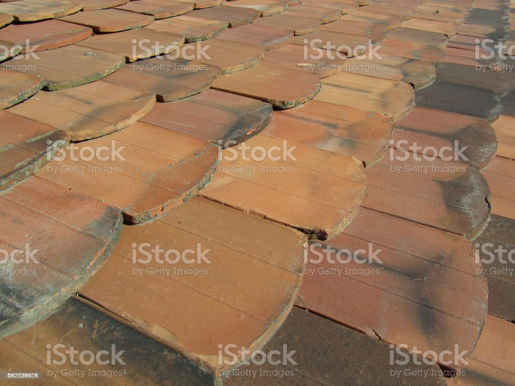 Old clay roof shingles stock photo