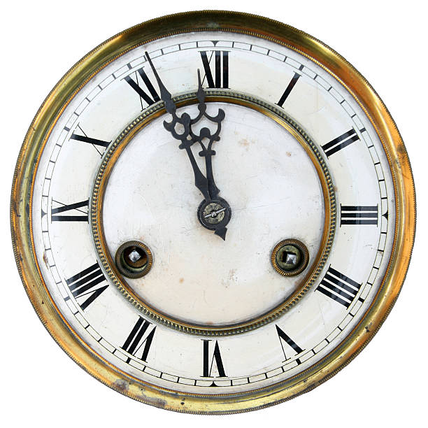 Old clock face isolated Old clock face isolated, roman numerals, about twelve midnight stock pictures, royalty-free photos & images
