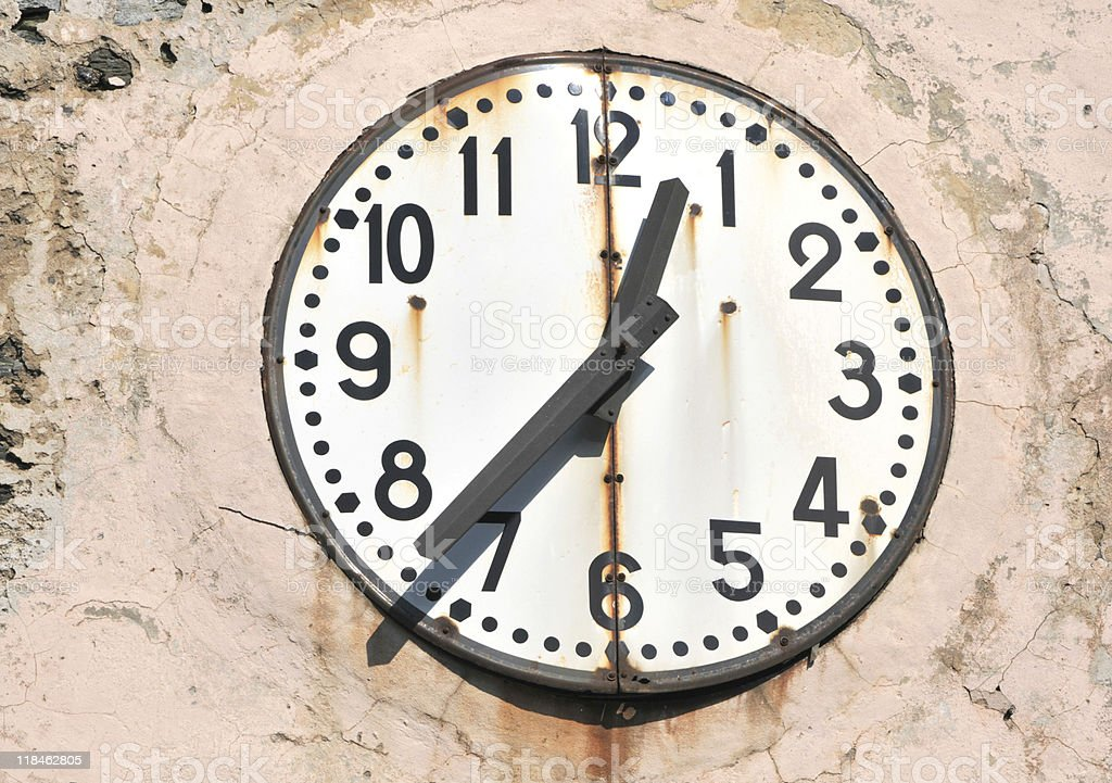 Old clock face on French Church, Corsica royalty-free stock photo